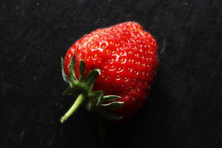 Photography of a strawberry on slate for food background 版權商用圖片