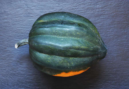 Photography of a winter squash on slate background for food illustrations