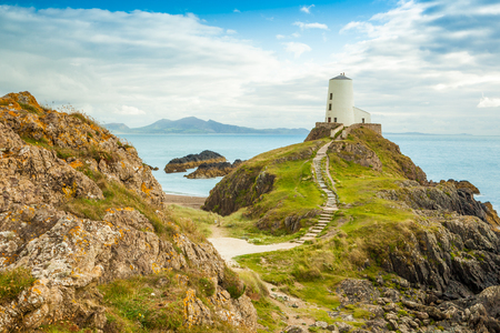 ynys: Lightouse on a hill overlooking the Menai Straits, Llanddwyn Island, Anglesey, North Wales