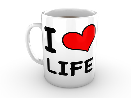 love life: White Mug isolated against a white background. Mug is printed with the words I Love Life and features a big red heart
