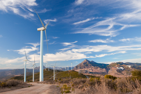 windfarms: Wind Turbines generating electricity on a remote hillside in Spain Stock Photo