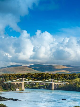 industrial heritage: Thoma Telfords Menai Bridge spanning the Menai Straits between Bangor and Angelesey, North Wales Stock Photo