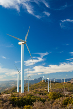 Wind Turbines generating electricity on a remote hillside in Spain Stock Photo