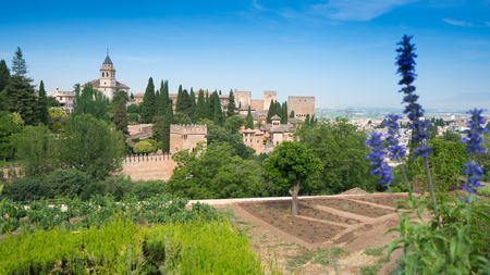 Gardens and view towards Granada with mountains in the background at the Alhambra Palace and fortress located in, Granada, Andalusia, Spain.