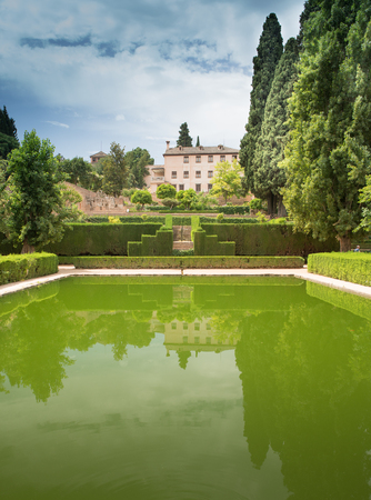 Deep green Carp lake at the Alhambra Palace and fortress located in, Granada, Andalusia, Spain. Publikacyjne