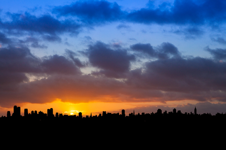 City Skyline Silhoutted Against a Blue and Orange Sky at Sunrise