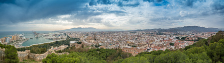 Highly detailed panaoramic view of the city of Malaga, Southern Spain, showing Malaga Port, Cathedral and other major landmarks Stock Photo