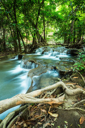 Huay Mae Kamin Waterfall in green forest, Kanchanaburi, Thailand photo