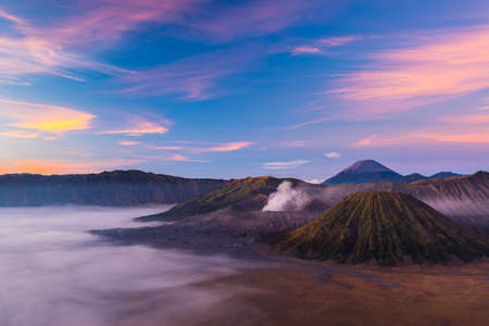 active volcano: Mount Bromo is an active volcano during sunrise located in East Java, Indonesia. Stock Photo