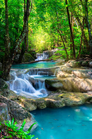 flowing: Beautiful waterfall in Thailand tropical forest Stock Photo
