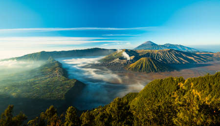 Mount Bromo volcano during sunrise, the magnificent view of Mt. Bromo located in Bromo Tengger Semeru National Park, East Java, Indonesia. Stock Photo