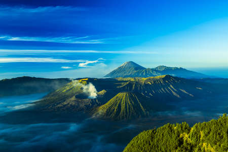 The active volcano of Mount Bromo while sunrise Stock Photo