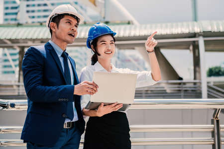 Trainee engineer present new idea to her manager at the site of work Stock Photo