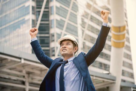 A Man happy as winning after completed his project
