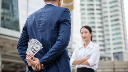 A man hiding his money from his girlfriend