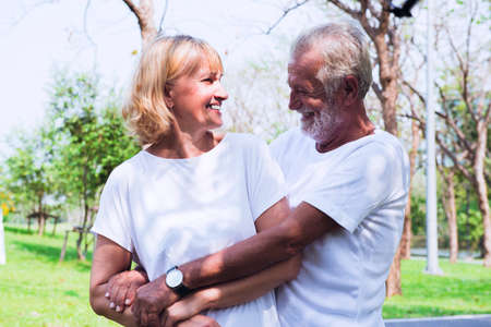 Happy old couple hugging in the park Stok Fotoğraf