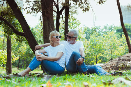Happy Senior couple sitting in the park, retirement concept Stok Fotoğraf