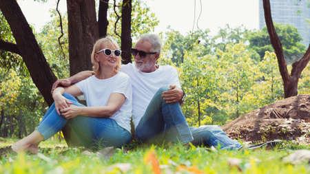 Happy senior couple relax in the park Stok Fotoğraf