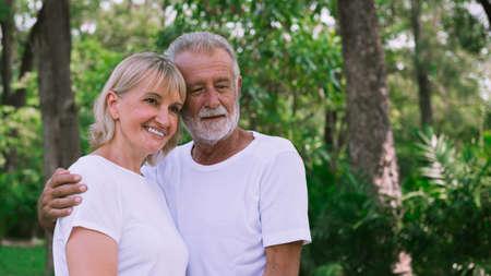Happy old couple hugging in the garden Stok Fotoğraf