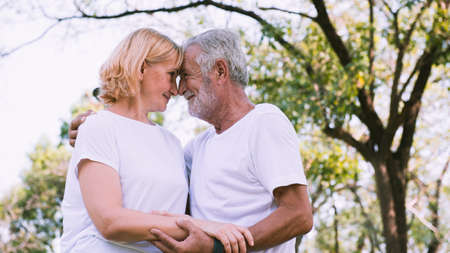Happy senior couple smiling in the park