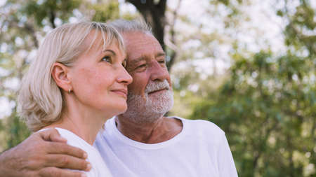Happy old couple relax in the garden