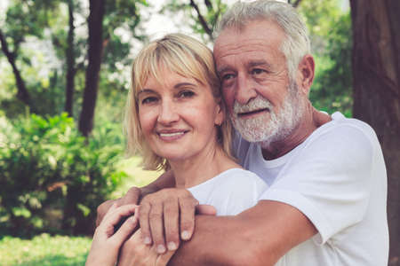 Happy senior couple enjoy activity in the park after retirement