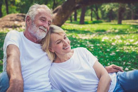 Portrait of a happy senior couple in park Stok Fotoğraf
