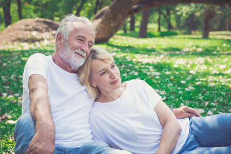 Portrait of a happy senior couple in park 写真素材
