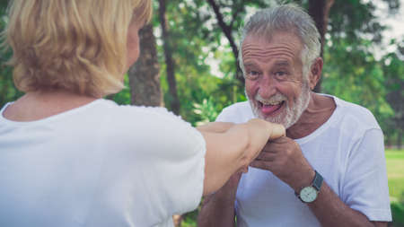 Happy old man in love with her wife in the park