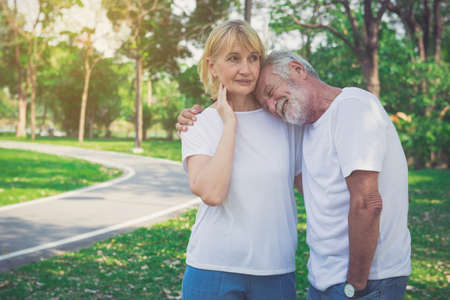 Happy old couple enjoy and relax in the park.