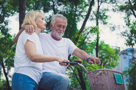 Beautiful senior couple with bicycles outside in spring nature. Stok Fotoğraf