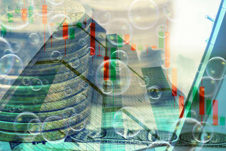 Double exposure of money and building with falling graph.