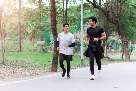 Two men jogging in the morning at the park