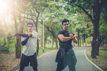 Two men stretching the muscle and warmup before jogging