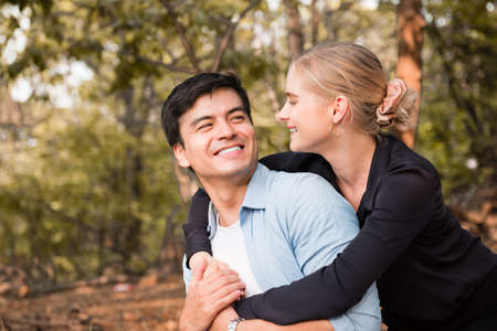 young happy couple relax in the park