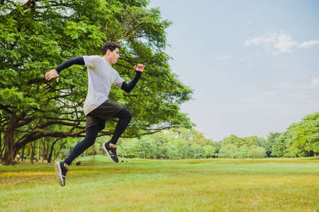 Young man jumping in the park
