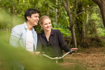 Young couple in love on bikes in the park
