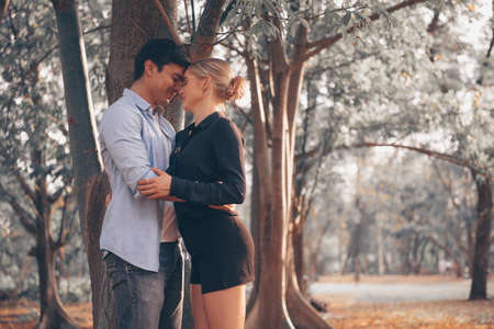 Happy young couple in love, hugging under the tree