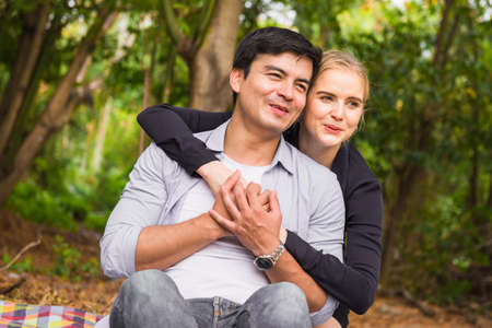couple is hugging and sitting close in the park Stockfoto