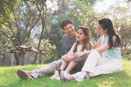 Happy family relax in the park during vacation.