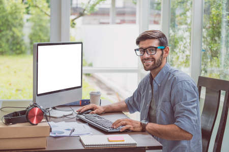 Smart man working from home with computer