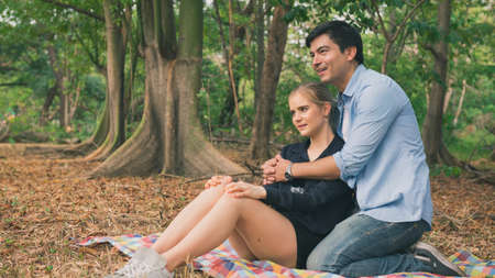 Young couple in love outdoor. Happy couple dating in the park.