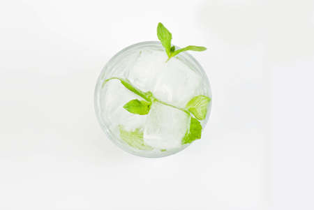 minty: Glass of water with fresh mint and ice cubes Stock Photo