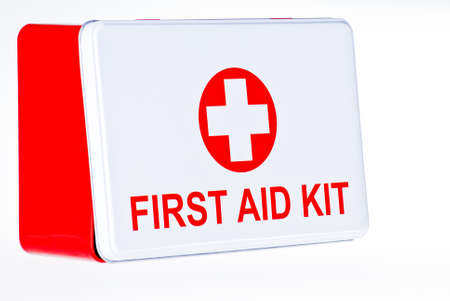 emergency kit: First aid kit box over white background