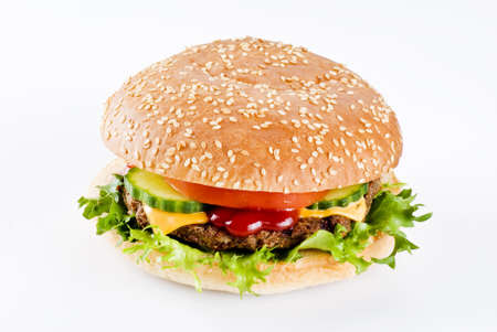 beefburger: Beefburger in sesame seed bun with vegetables isolated
