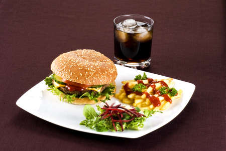Beefburger with crispy salad leaves and chips photo