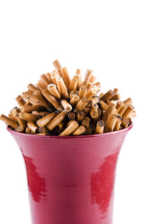Full bowl of cigarettes end over white background Stock Photo - 9641829