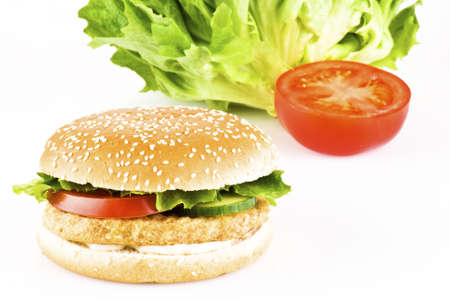 Chicken burger with tomato cucumber lettuce and mayonnaise  photo