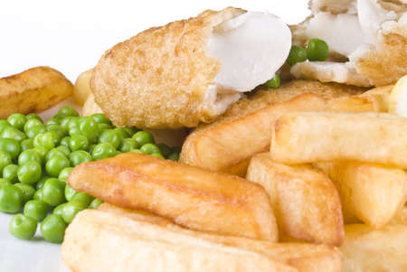 Fried fish and chips with lemon and peas - isolated photo