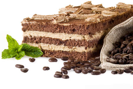 coffe beans: Tiramisu cake with bag of coffe beans isolated over white
